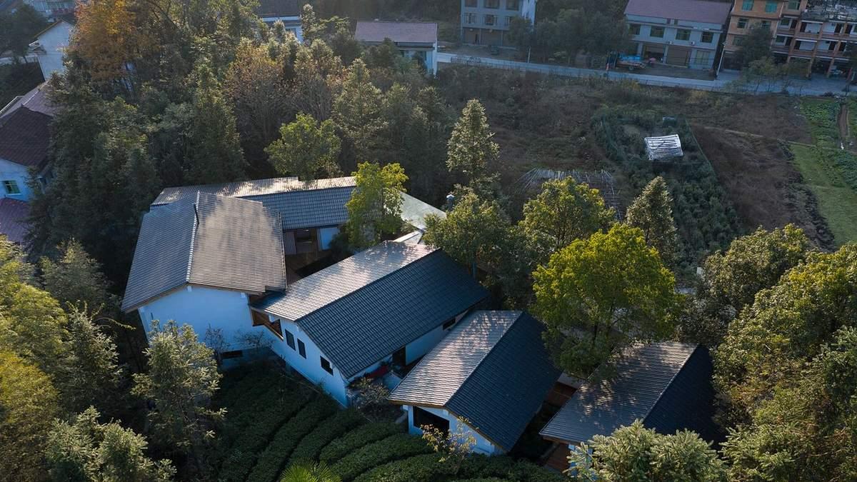 Горное строительство: в Китае соединили 5 домов и превратили их в отель – фото
