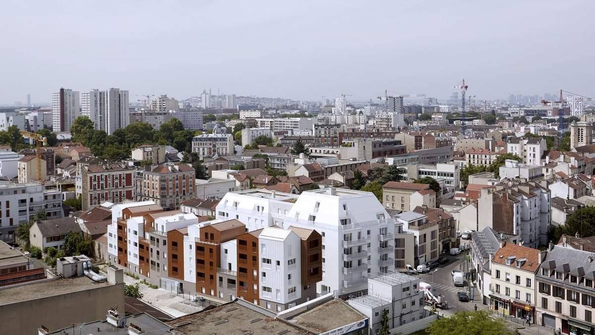 Контраст білого і коричневого: в Парижі побудують цілий мікрорайон з однакових будиночків – фото