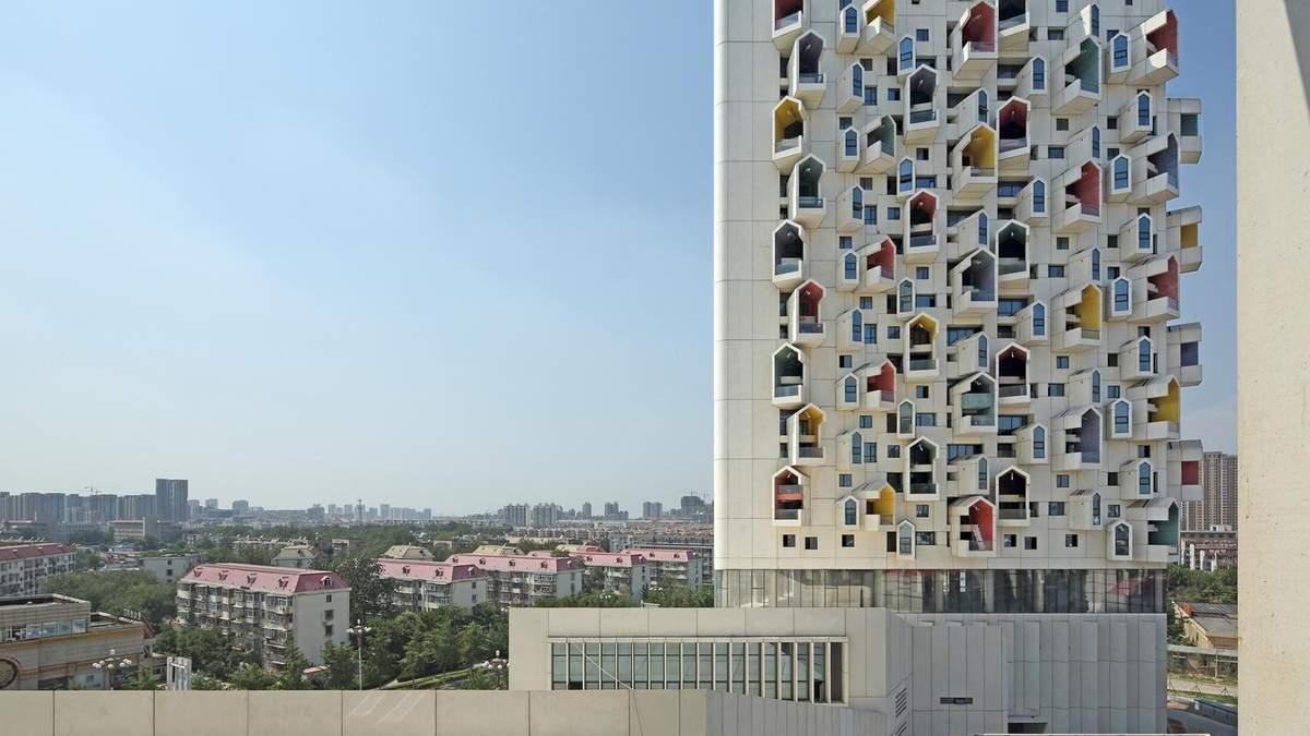 Тривимірні будинки: в Китаї звели багатоповерхівки з дивними терасами – фото