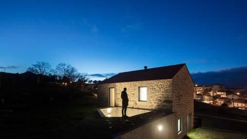 Ради безопасности: в Португалии построили жилье с рыболовной сеткой над двором – фото