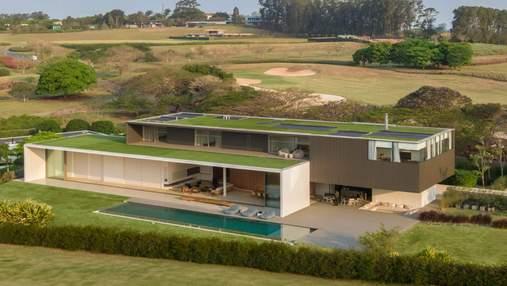 Зеленая крыша и бассейн: роскошный дом для отдыха с полями для гольфа – фото