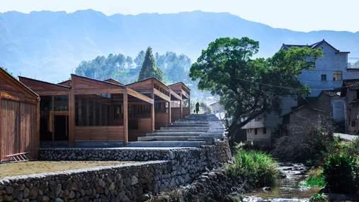 Лестницы в горах: в Китае построили интерактивный деревянный завод по изготовлению тофу – фото