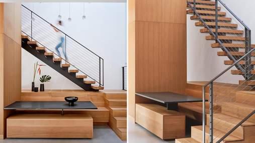 Облаштування простору: у дизайн сходів вмонтували обідню зону